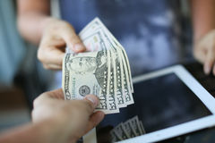 Money on the background of the tablet Stock Photography