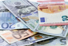 Money background - US dollars and euro Stock Images