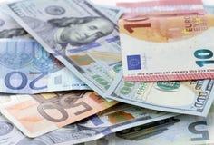 Money background - US dollars and euro Stock Images