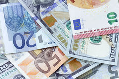 Money background - US dollars and euro Royalty Free Stock Photography