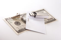 Money, badge and USB flash drive Stock Photo