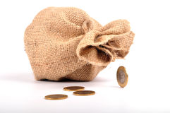 Money bag. On white, coins out of bag stock photo