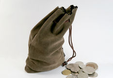 Money bag. Bag of money, some coins out of it Stock Photos