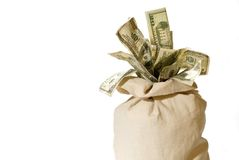 Money Bag!. Canvas Bank Bag Bursting with Cash Royalty Free Stock Images
