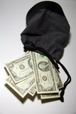Money bag. Drawstring bag filled with paper money royalty free stock image
