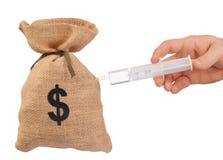 Money Bag. And hand holding a syringe isolated on white royalty free stock photo
