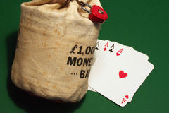 Money bag and aces. Close up on green background Royalty Free Stock Photos