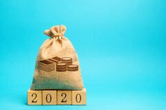 Free Money Bag And Wooden Blocks 2020. Budget Planning. Business And Economic. Goals And Plans. Investment, Finance. Savings. Copy Stock Images - 172909764