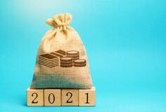 Free Money Bag And Wooden Blocks 2021. Budget Planning. Business And Economic. Goals And Plans. Investment, Finance. Savings Stock Image - 173707881