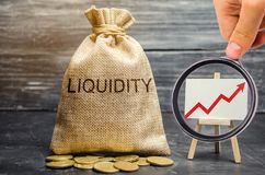 Money bag and arrow up. Increase liquidity and profitability of investments. High interest rates on deposits and securities. Profitable shares. Promising stock images