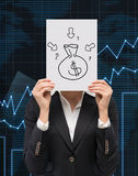 Money bag. Businesswoman holding placard with drawing money bag Royalty Free Stock Photography