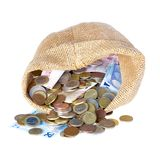 Money bag with coins and banknotes isolated over white Stock Photography