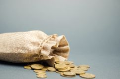 Money bag and coins falling from it. Concept of savings and the economy. Deposit. Cost control. Profit and liquidity. Cash. Management. Distribution of money stock photography