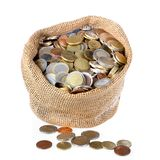Money bag with coins isolated over white Royalty Free Stock Images