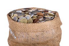 Money bag with coins isolated at a white background Royalty Free Stock Image