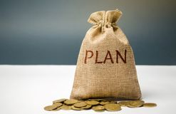 Money bag with coins and the word Plan. Personal financial planning concept. Management of the family budget. Savings and royalty free stock images