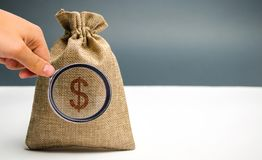 Money bag with a dollar sign. Family or company budget concept. Income and profit. The accumulation of capital. Salary savings. Pension payments. Cash savings stock images
