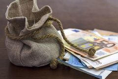 Money bag and euro banknotes.  royalty free stock photo