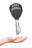 Money bag flies with his hands Stock Photo