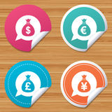 Money bag icons. Dollar, Euro, Pound and Yen. Royalty Free Stock Photography