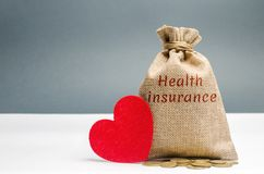 Money bag with the inscription Health Insurance and a red heart. The concept of medical insurance of life, family, health. royalty free stock images