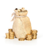 Money in bag and stack of coins. Isolated on white Royalty Free Stock Image