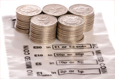 Money bag with sterling ten pence coins Stock Image