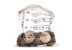 Money bag of sterling twenty pence coins Royalty Free Stock Image