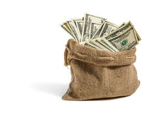 Money in the bag. Studio photography of bag with hundred dollar bills stock image