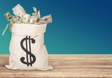 Money bag on the table. Currency paper currency wealth bag incentive dollar sign stock images