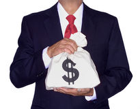 MONEY BAG FINANCIAL PLANNING WEALTH MANAGEMENT. Wealth, security provided with the holding of money. Businessman holding money bag. Financial planning, wealth Royalty Free Stock Photo