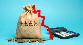 Free Money Bag With The Word Fees And Arrow Down. The Concept Of Reducing Duties On The Import Or Export Of Goods And Services. Royalty Free Stock Photos - 155803118