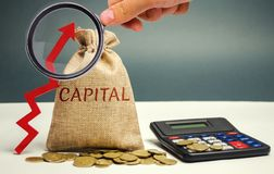 Money bag with the word Capital and an up arrow. The concept of accumulation and increase in money capital. Increase in capital stock photography