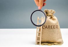 Money bag with the word Career and a wooden ladder. Self-development and leadership skills. Career ladder is a process of career. Growth, the achievement of stock image