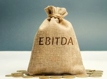 Money bag with the word Ebitda. Earnings before interest, taxes, depreciation and amortization. Financial result of the company. stock photo