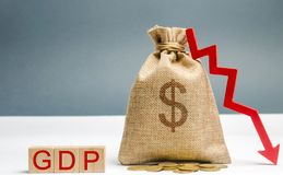 Money bag with the word GDP and down arrow. Decline and decrease of GDP - failure and breakdown of economy and finances leading to. Financial crisis and trouble stock photography