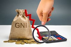 Money bag with the word GNI and the arrow down. The financial and economic crisis in the country. Stagnation. Reform of the. Economy. Capital outflow. Analysis royalty free stock images