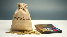 Money bag with the word Payroll and calculator. Payroll is the sum total of all compensation a business must pay to its employees stock image