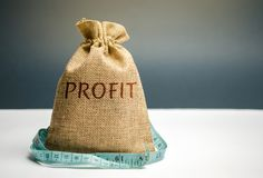 Money bag with the word Profit and tape measure. The concept of limited profit. Lack of money and poverty. Small income. Salary. Reduction. Unsuccessful stock images