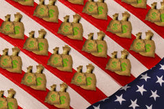 Money bags on American flag Royalty Free Stock Photo