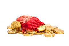 Money bags and gold COINS. With `good luck` printed on them stock images
