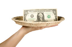 Money in bamboo tray Royalty Free Stock Image