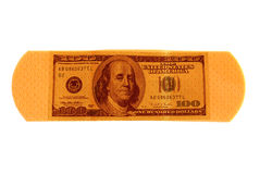 Money bandaid. Money in the form of a medical bandaid royalty free stock image