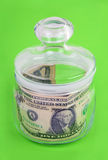 Money in the bank. Keep the money in the bank. One dollar. Green background Stock Photography