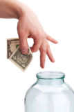 Money in the bank. Hand placing money into bank Stock Images