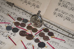 Money. Bank interest coin antique old merit wage clock Time song melody note clay dynamite provision capital plant Stock Photos