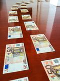 Money bank notes on the floor, best way to follow to get money, walking on the money walkway. Bank note footprint royalty free stock photos