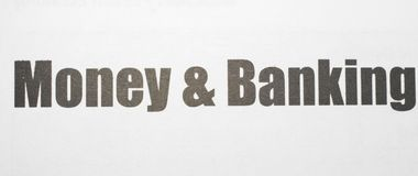 Money and Banking Printed on a white background with black ink royalty free stock photos