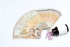 Money banknote in fan shape and purple capsules splash out from Royalty Free Stock Photo