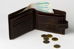 Money. Banknotes in a wallet and coins shot on an isolated white background Stock Photo